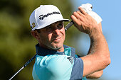 Dustin Johnson of the United States plays the ball from the seventeenth tee during round three of the 2016 RBC Canadian Open at Glen Abbey Golf...