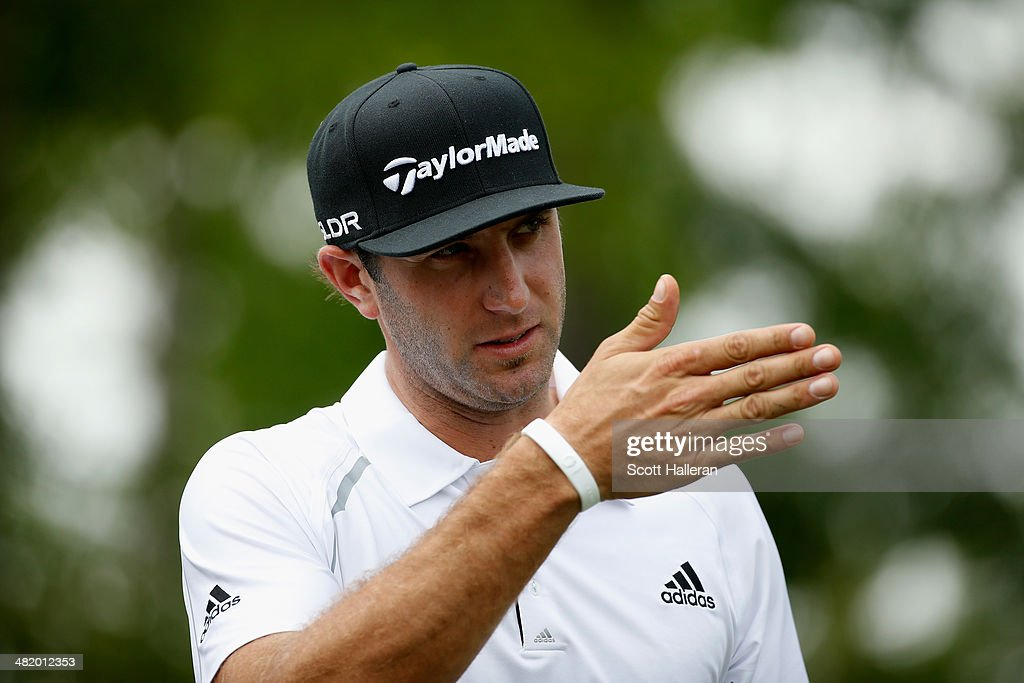 <a gi-track='captionPersonalityLinkClicked' href=/galleries/search?phrase=Dustin+Johnson&family=editorial&specificpeople=3908453 ng-click='$event.stopPropagation()'>Dustin Johnson</a> of the United States points during the pro-am prior to the start of the Shell Houston Open at the Golf Club of Houston on April 2, 2014 in Humble, Texas.