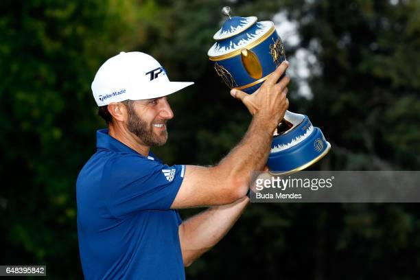 Dustin Johnson of the United States poses with his trophy after winning the World Golf Championships Mexico Championship at Club De Golf Chapultepec...