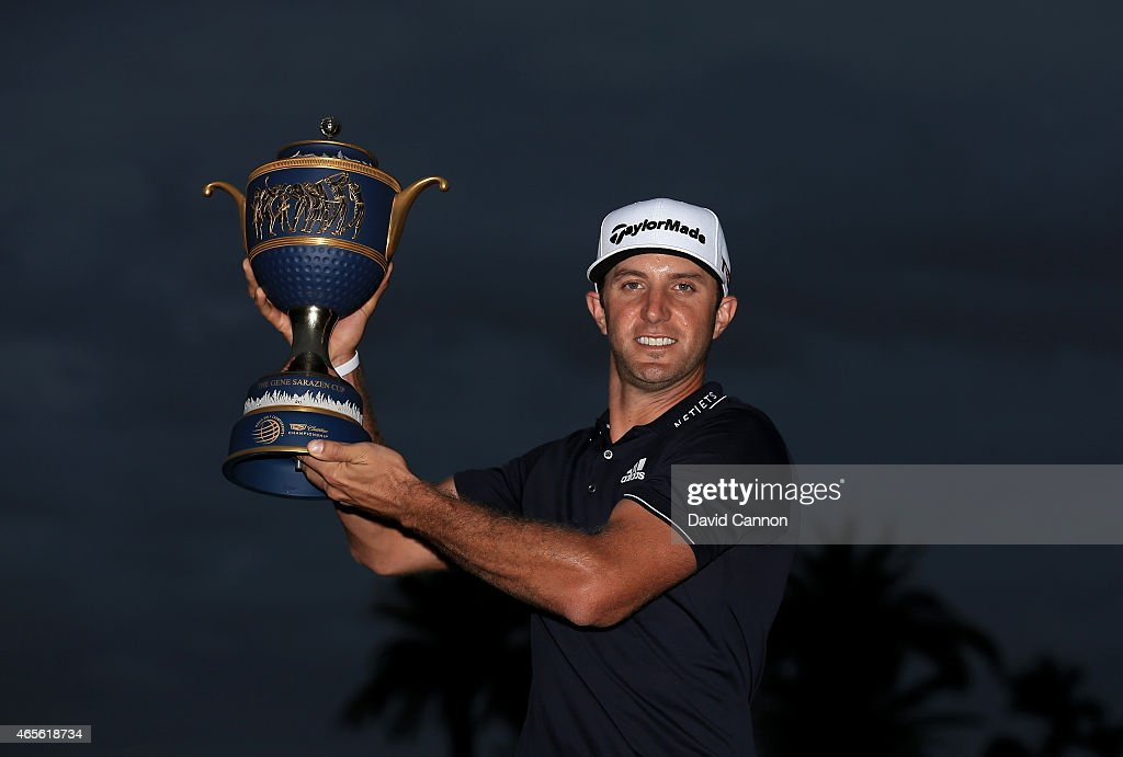 Dustin Johnson of the United States poses with the Gene Sarazen Cup after winning the World Golf Championships-Cadillac Championship at Trump National Doral Blue Monster Course on March 8, 2015 in Doral, Florida.
