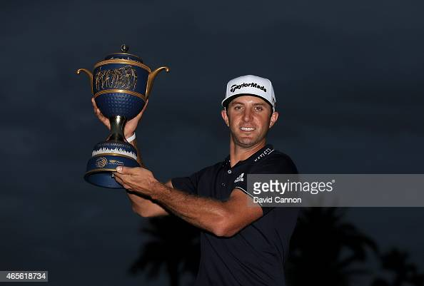 Dustin Johnson of the United States poses with the Gene Sarazen Cup after winning the World Golf ChampionshipsCadillac Championship at Trump National...