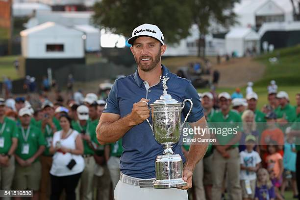 Dustin Johnson of the United States poses with the winner's trophy after winning the US Open at Oakmont Country Club on June 19 2016 in Oakmont...