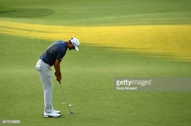 Dustin Johnson of the United States putts for birdie on the 18th green during the final round of the US Open at Oakmont Country Club on June 19 2016...