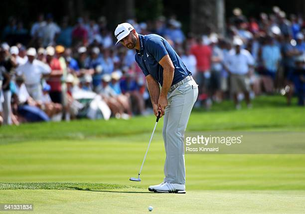 Dustin Johnson of the United States putts for eagle on the second hole during the final round of the US Open at Oakmont Country Club on June 19 2016...
