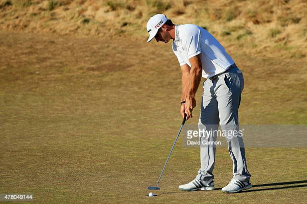 Dustin Johnson of the United States putts for par on the 18th green during the final round of the 115th US Open Championship at Chambers Bay on June...
