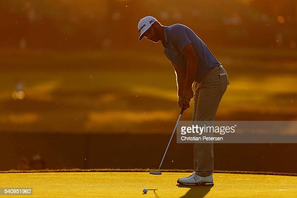 Dustin Johnson of the United States putts on the seventh green during the second round of the US Open at Oakmont Country Club on June 17 2016 in...