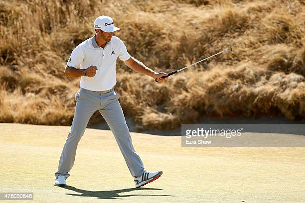 Dustin Johnson of the United States reacts after making a putt on the sixth hole during the final round of the 115th US Open Championship at Chambers...