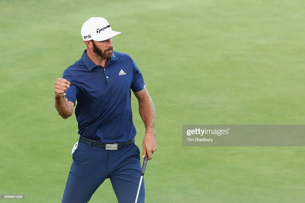 Dustin Johnson of the United States reacts after putting on the 18th green during the final round of The Northern Trust at Glen Oaks Club on August 27, 2017 in Westbury, New York.