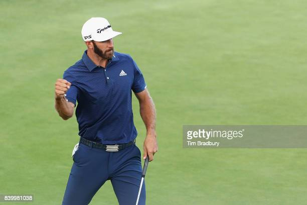 Dustin Johnson of the United States reacts after putting on the 18th green during the final round of The Northern Trust at Glen Oaks Club on August...