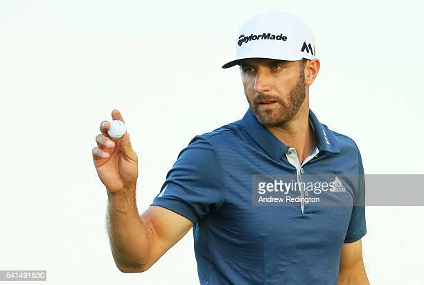 Dustin Johnson of the United States reacts after saving par on the 17th green during the final round of the US Open at Oakmont Country Club on June...