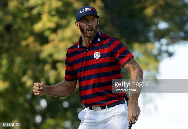 Dustin Johnson of the United States reacts on the 12th green during afternoon fourball matches of the 2016 Ryder Cup at Hazeltine National Golf Club...