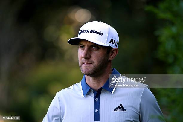 Dustin Johnson of the United States reacts on the 13th hole during the third round of the 2016 Masters Tournament at Augusta National Golf Club on...