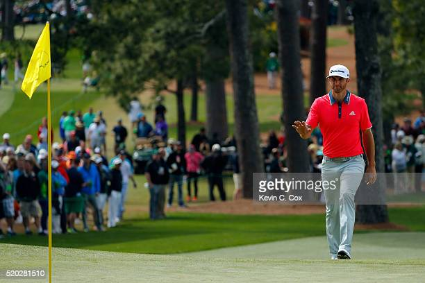 Dustin Johnson of the United States reacts on the seventh green during the final round of the 2016 Masters Tournament at Augusta National Golf Club...