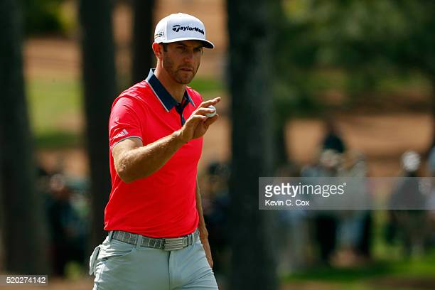 Dustin Johnson of the United States reacts on the seventh hole during the final round of the 2016 Masters Tournament at Augusta National Golf Club on...