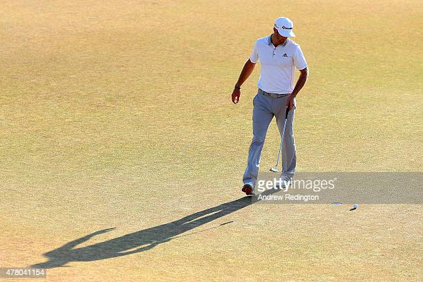 Dustin Johnson of the United States reacts to a missed birdie putt on the 18th green during the final round of the 115th US Open Championship at...