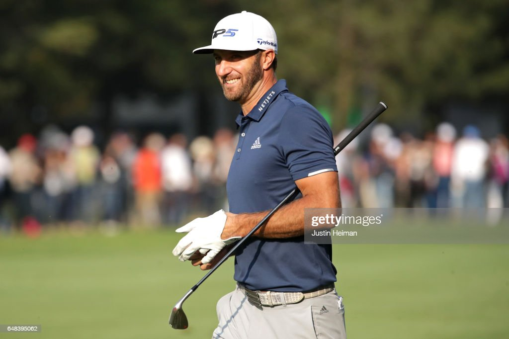 Dustin Johnson of the United States smiles after playing his second shot on the 18th hole during the final round of the World Golf Championships Mexico Championship at Club De Golf Chapultepec on March 5, 2017 in Mexico City, Mexico.