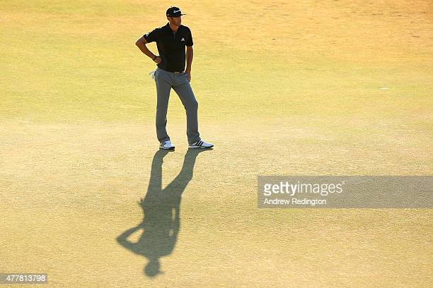 Dustin Johnson of the United States stands on the 18th green during the second round of the 115th US Open Championship at Chambers Bay on June 19...