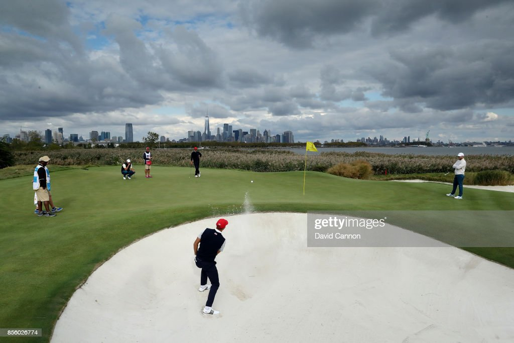 Dustin Johnson of the United States team plays his second shot on the 10th hole in his match with Brooks Koepka against Branden Grace and Marc Leishman of the International team during the Saturday afternoon fourball matches in the 2017 Presidents Cup at the Liberty National Golf Club on September 30, 2017 in Jersey City, New Jersey.