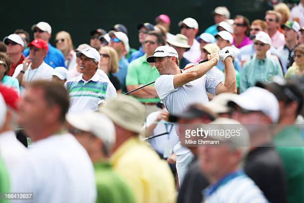 Dustin Johnson of the United States tees off on the eighth hole during the second round of the 2013 Masters Tournament at Augusta National Golf Club...