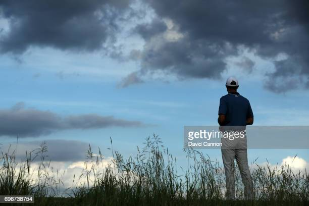 Dustin Johnson of the United States waits to play his tee shot on the par 3 16th hole during the second round of the 117th US Open Championship at...