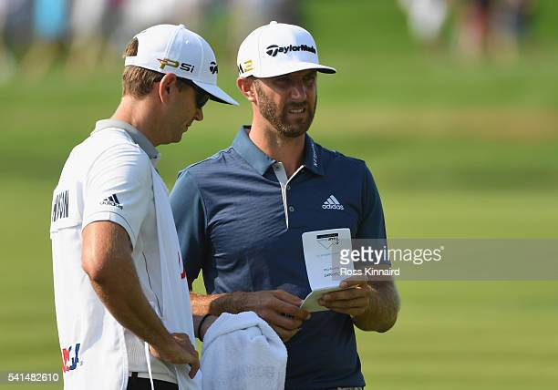 Dustin Johnson of the United States waits with his brother/caddie Austin during the final round of the US Open at Oakmont Country Club on June 19...