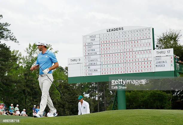 Dustin Johnson of the United States walks across the 18th green during the second round of the 2015 Masters Tournament at Augusta National Golf Club...