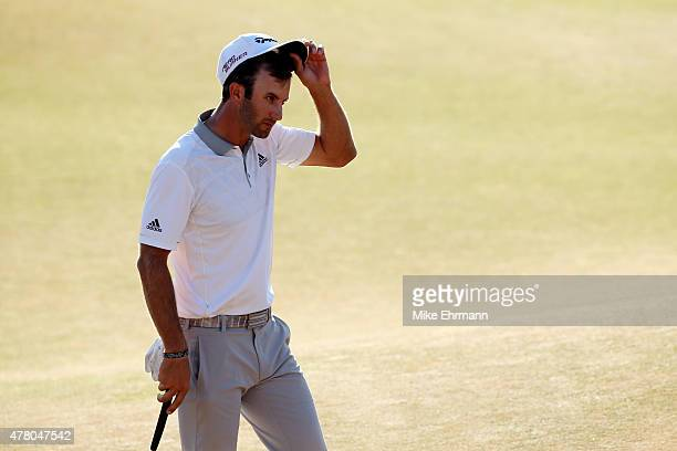 Dustin Johnson of the United States walks off the 18th green after making par during the final round of the 115th US Open Championship at Chambers...
