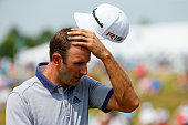 Dustin Johnson of the United States walks off the first green during the final round of the 2015 PGA Championship at Whistling Straits on August 16...