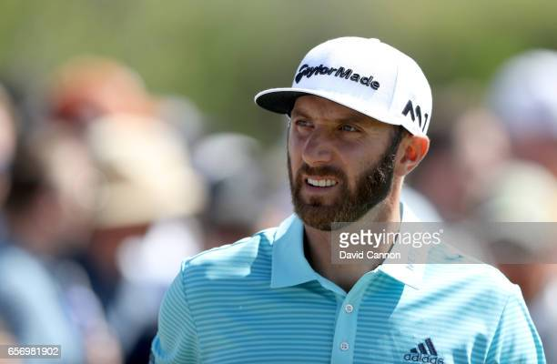 Dustin Johnson of the United States walks off the tee on the par 4 second hole in his match against Martin Kaymer during the second round of the 2017...