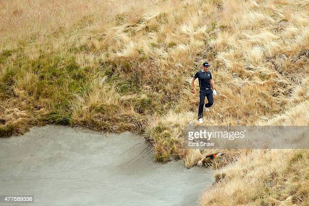 Dustin Johnson of the United States walks through the rough on the tenth hole during the first round of the 115th US Open Championship at Chambers...
