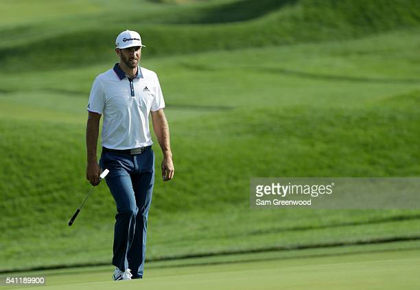 Dustin Johnson of the United States walks up the 18th fairway during a continuation of the third round of the US Open at Oakmont Country Club on June...