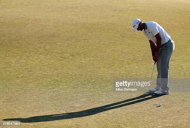Dustin Johnson of the United States watches a missed birdie putt on the 18th green during the final round of the 115th US Open Championship at...
