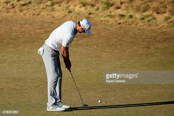 Dustin Johnson of the United States watches his missed birdie putt on the 18th green during the final round of the 115th US Open Championship at...