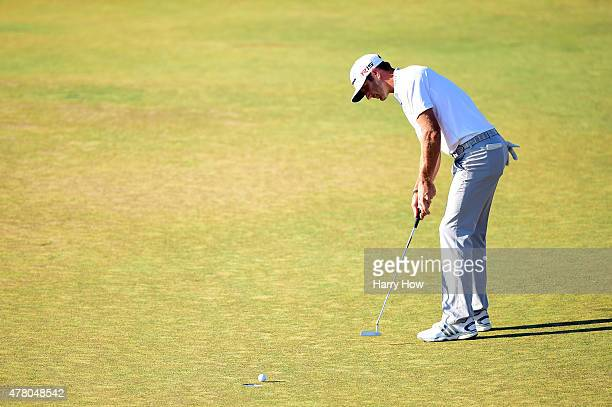 Dustin Johnson of the United States watches his missed eagle putt on the 18th green during the final round of the 115th US Open Championship at...