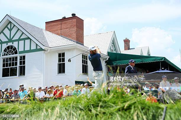 Dustin Johnson of the United States watches his tee shot on the first hole during the final round of the US Open at Oakmont Country Club on June 19...