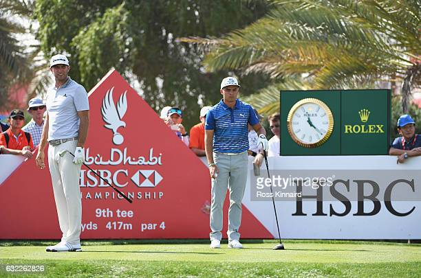 Dustin Johnson of the United States watches his tee shot with Rickie Fowler on the 9th hole during the third round of the Abu Dhabi HSBC Championship...