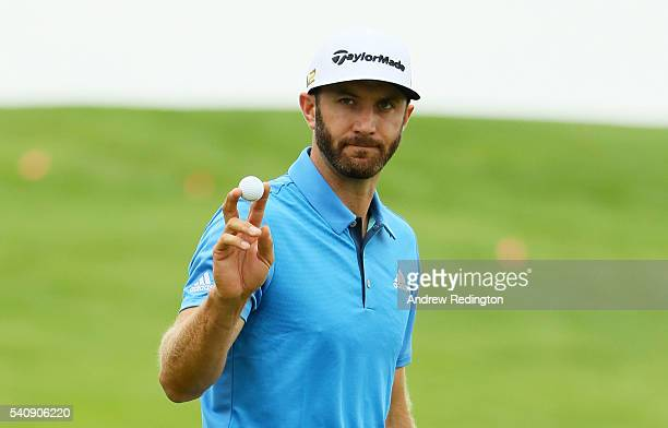 Dustin Johnson of the United States waves to the gallery on the first green during the continuation of the weather delayed first round of the US Open...