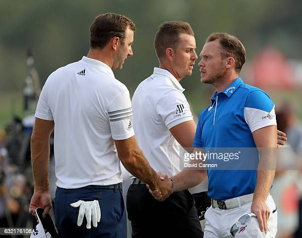 Dustin Johnson of the United States winer of the 2016 US Open shakes hands with Danny Willett of England winner of the 2016 Masters Tournament as...