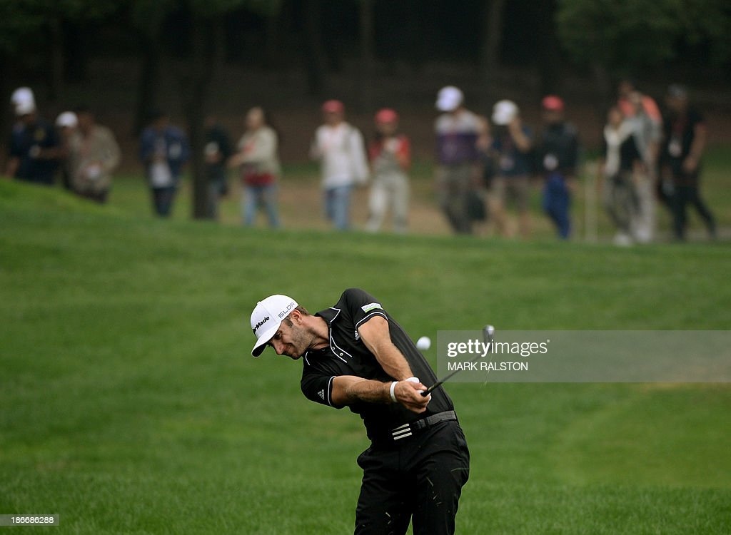 Dustin Johnson of the US plays from the rough at the 8th hole before winning the WGC-HSBC Champions tournament at the Shanghai Sheshan International Golf Club on November 3, 2013. AFP PHOTO/Mark RALSTON