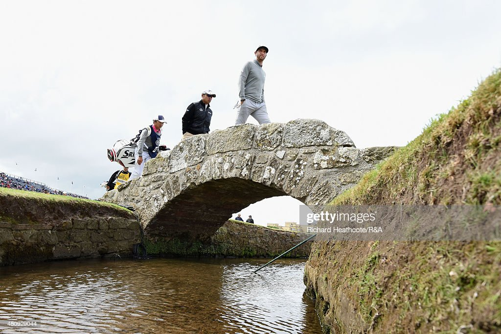 Dustin Johnson of the USA and Hideki Matsuyama of Japan walk across the Swilcan Bridge during the first round of the 144th Open Championship at The Old Course on July 16, 2015 in St Andrews, Scotland.