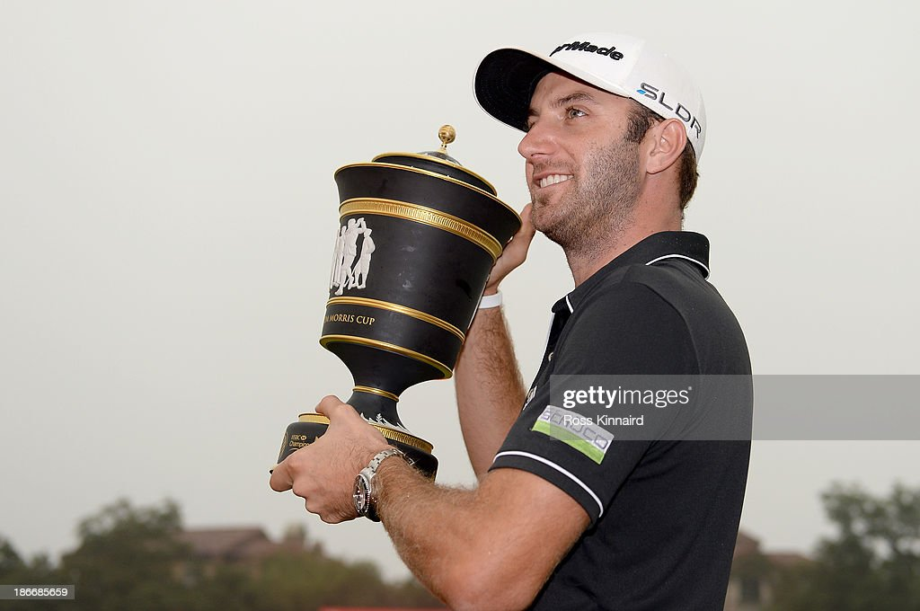 Dustin Johnson of the USA celebrates with the winners trophy after the final round of the WGC - HSBC Champions at the Sheshan International Golf Club on November 3, 2013 in Shanghai, China.