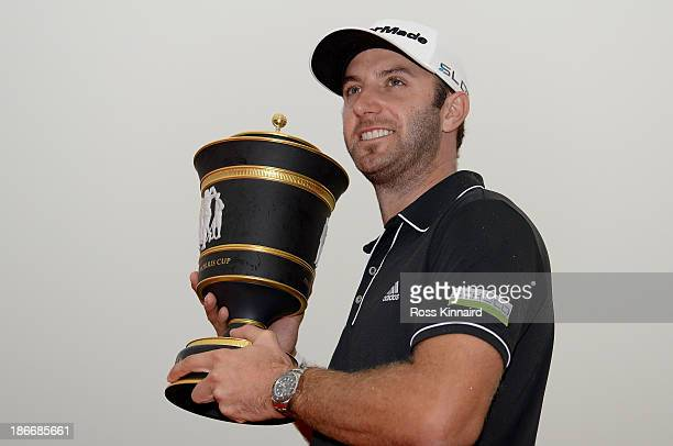 Dustin Johnson of the USA celebrates with the winners trophy after the final round of the WGC HSBC Champions at the Sheshan International Golf Club...