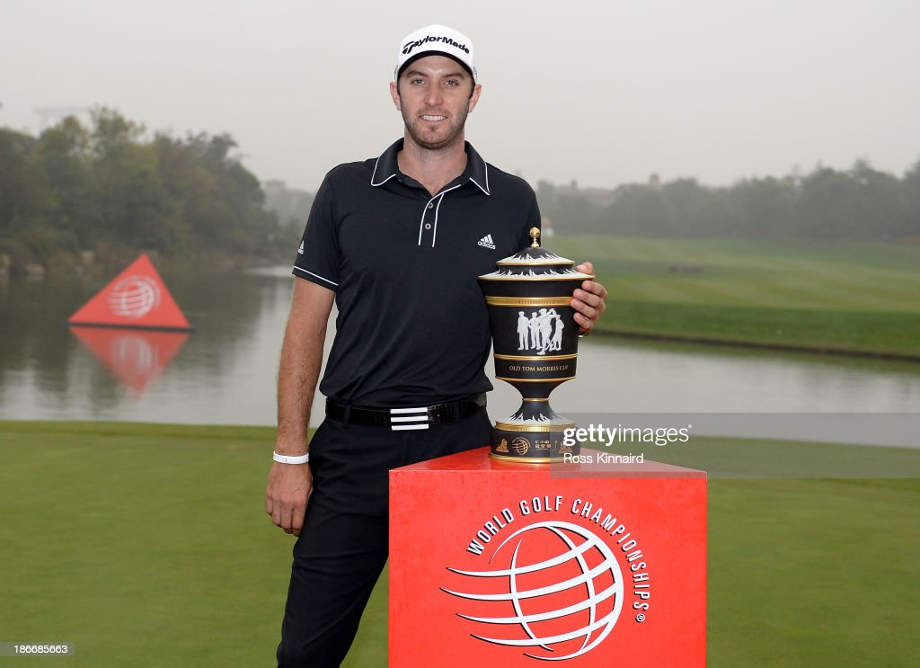 <a gi-track='captionPersonalityLinkClicked' href=/galleries/search?phrase=Dustin+Johnson&family=editorial&specificpeople=3908453 ng-click='$event.stopPropagation()'>Dustin Johnson</a> of the USA celebrates with the winners trophy after the final round of the WGC - HSBC Champions at the Sheshan International Golf Club on November 3, 2013 in Shanghai, China.