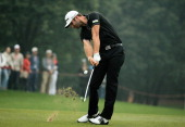 Dustin Johnson of the USA hits a shot on the ninth hole during the final round of the WGCHSBC Champions at the Sheshan International Golf Club on...
