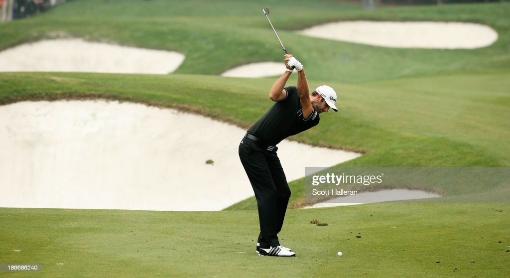 Dustin Johnson of the USA hits a shot on the seventh hole during the final round of the WGC-HSBC Champions at the Sheshan International Golf Club on November 3, 2013 in Shanghai, China.
