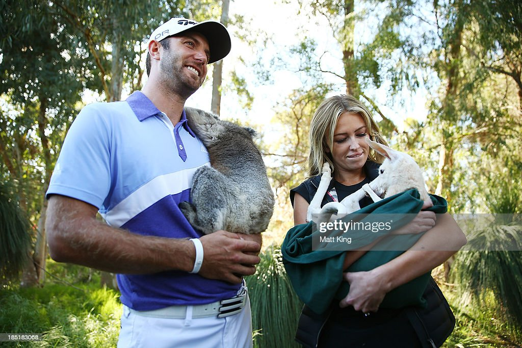 <a gi-track='captionPersonalityLinkClicked' href=/galleries/search?phrase=Dustin+Johnson&family=editorial&specificpeople=3908453 ng-click='$event.stopPropagation()'>Dustin Johnson</a> of the USA nurses a Koala with his partner <a gi-track='captionPersonalityLinkClicked' href=/galleries/search?phrase=Paulina+Gretzky&family=editorial&specificpeople=2646375 ng-click='$event.stopPropagation()'>Paulina Gretzky</a> as she nurses a Joey during day two of the Perth International at Lake Karrinyup Country Club on October 18, 2013 in Perth, Australia.