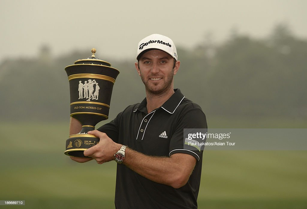 <a gi-track='captionPersonalityLinkClicked' href=/galleries/search?phrase=Dustin+Johnson&family=editorial&specificpeople=3908453 ng-click='$event.stopPropagation()'>Dustin Johnson</a> of the USA pictured with the winnner's trophy after round four of the WGC - HSBC Champions at Sheshan International Golf Club on November 3, 2013 in Shanghai, China.