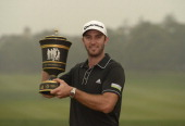 Dustin Johnson of the USA pictured with the winnner's trophy after round four of the WGC HSBC Champions at Sheshan International Golf Club on...