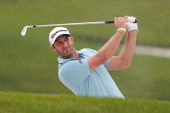Dustin Johnson of the USA plays a chip shot during the third round of the WGC HSBC Champions at the Sheshan International Golf Club on November 2...