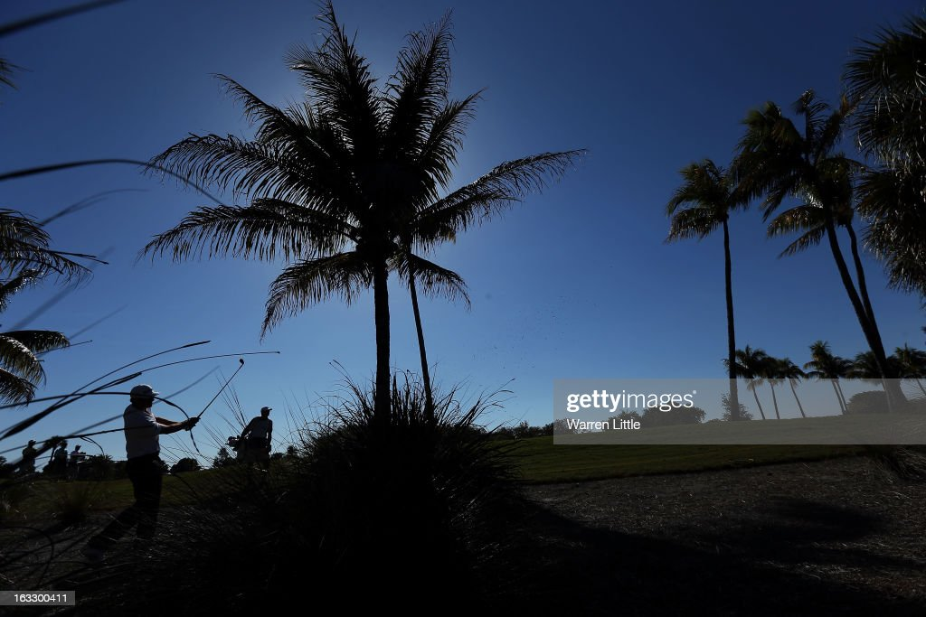 Dustin Johnson of the USA plays out of the bushes on the 12th hole during the first round of the WGC-Cadillac Championship at the Trump Doral Golf Resort & Spa in Miami, Florida.